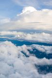 Above the Clouds. View of different types of clouds taken from a plane. Clouds form when the dewpoint of water is reached in the presence of condensation nuclei Royalty Free Stock Images