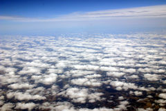 Above the clouds. An image of clouds shot from an airplane between two layers of stratus and cumulus stock photography