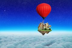 Balloon flies above the clouds. The concept of travel. Above the clouds an air-red balloon flies. The concept of travel stock photo
