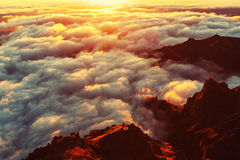 Above clouds. Beautiful sunset on the hill above clouds Stock Photos