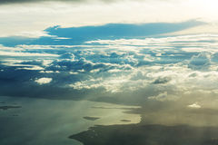 Above clouds. Beautiful view above clouds from the aircraft Royalty Free Stock Image