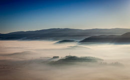 Above the clouds in a beautiful winter day Royalty Free Stock Images
