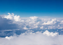 Above the Clouds. And Blue Sky Royalty Free Stock Photos