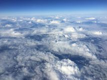 Above the clouds in the blue sky. From the plane Stock Images