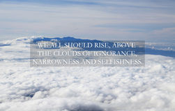Above the clouds. Blurry cloud and sky with Inspirational quote - We all should rise above the clouds of ignorance, narrowness and selfishness Royalty Free Stock Photos