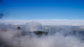 Above clouds carpet, Madeira. A carpet of clouds extending to the horizon at Pico do Areeiro. Madeira, Portugal Stock Photos