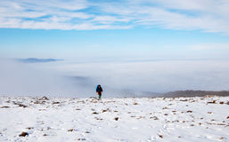 Above the clouds. Climber above the clouds in Crimean mountains stock photo