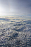 Above clouds. Fluffy clouds taken form above flying in a plane  on a sunny day Stock Images