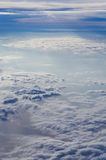 Above clouds. Fluffy clouds taken form above flying in a plane  on a sunny day Royalty Free Stock Photography