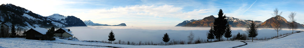 Above the Clouds. The fog rolled into the valleys during the night leaving a sea of fog at our doorstep Stock Photography