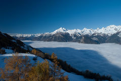 Above the clouds. The formation of this kind of fog is more favorable in the autumn with the first major cooling, often associated with disturbed cloud passages Royalty Free Stock Photography