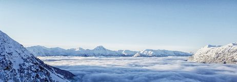 Above the Clouds - Girdwood, Alaska. Picture of the Chugiach Mountains in Girdwood, Alaska. This stunning view can be seen while skiing at the top. On this stock photography