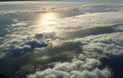 Above the clouds. Looking at the ocean through the clouds Royalty Free Stock Images