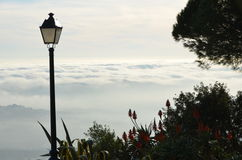 Above the clouds in Mijas spain. Afternoon view of the clouds from a park in the village of Mijas Spain on the Costa del Sol Stock Photo