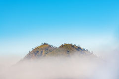 Above the clouds - Mountain summit above clouds Royalty Free Stock Photo