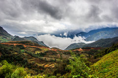 Above the clouds. Mountain view from the top Royalty Free Stock Photo