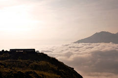 Above clouds with a mountain volcano view Stock Images