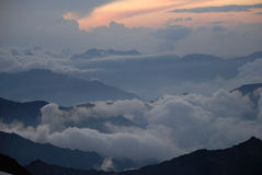 Above clouds and mountains Royalty Free Stock Images