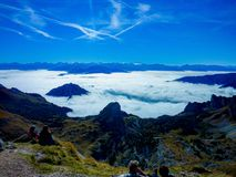 Above the clouds panorama. Reaching altitude of 1200m of Alpen mountains can see how clouds floating is below the ground stock images