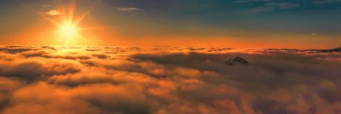 Above the clouds panoramic sunrise Stock Photo
