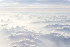 Above The Clouds. Photo was taken on the airplane on altitude of about 33000 feet Stock Image