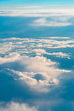 Above The Clouds. This picture was taken out of an airplane and shows the beautiful cloudscape in the evening light Stock Images