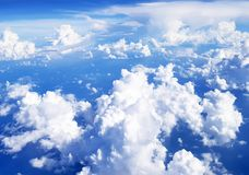 Flying over clouds in plane. Stock Photo