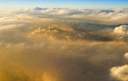 Above the clouds at sunset sunrise Royalty Free Stock Photo