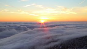 Above the clouds. Time lapse of low clouds in sunrise light