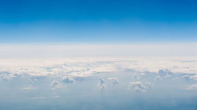 Above the clouds. Above the white clouds in the blue sky Stock Photography