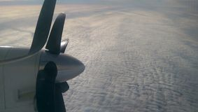 Above clouds. White clouds taken form above while flying in a plane royalty free stock image