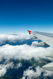 Above the clouds.Wing aircraft in the sky. Royalty Free Stock Photo