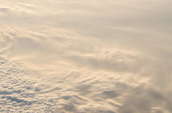 Above cloudscape with soft sunshine in the morning. Shoot form airplane Royalty Free Stock Photos
