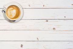 Above coffee cup on white wooden paint table with copy space. stock images