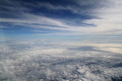 Above the deck - white clouds, deep blue sky Royalty Free Stock Image