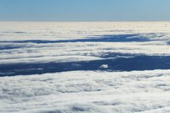 Above flowing clouds Stock Image