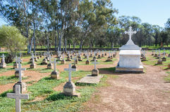 Above Ground Memorial: New Norcia Cemetery. NEW NORCIA,WA,AUSTRALIA-JULY 15,2016: Peaceful New Norcia Cemetery with gravestones in ordered rows with crosses and stock photo