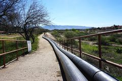 Above ground pipeline disappears in the distance Royalty Free Stock Photography