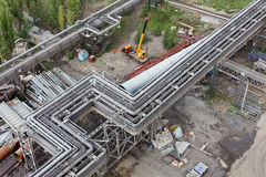 Above-ground pipeline on the factory. Factory heat supply network between works by above-ground pipelines Stock Images