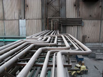 Above-ground pipeline on the factory. Factory heat supply network between works by above-ground pipelines Stock Photography