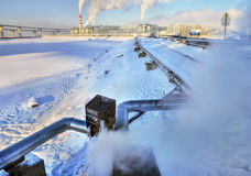 Above ground pipeline, insulated pipeline hot water winter day. Stock Images