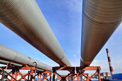 Above-ground pipeline, lower shot against blue sky Royalty Free Stock Photos