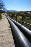 Above ground pipeline recedes in the distance Royalty Free Stock Image