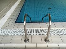Above-ground swimming pool ladder. Swimming pool climbing ladder Royalty Free Stock Image