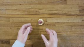 From above hands make dumpling on wooden table. Top view on making dumpling. Dumplings, flour, leeks, rolling pin, on. Wooden table stock video footage
