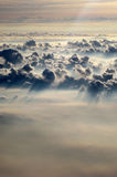 Above Henvenly Clouds with Sun Casting Light Royalty Free Stock Photos