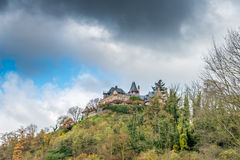 Above. Image of a house on a hill against a stormy looking sky stock photography
