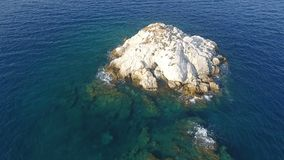Above Islet 2. Flying above a small barron islet of the Aegean Sea in Greece stock footage