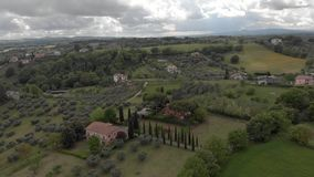 Above Italian countryside with valley, forests and olive trees and green meadows