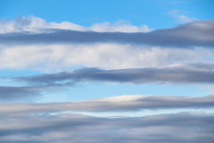 Above layers and blue sky. Pattern formed by stratocumulus clouds adorn an early evening blue sky royalty free stock images